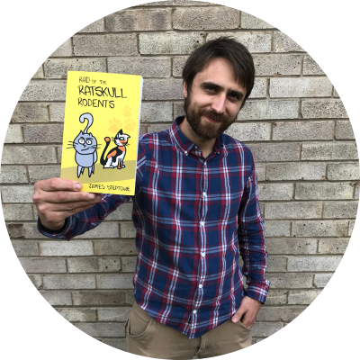 Children's author James holding his debut book, Raid of the Ratskull Rodents